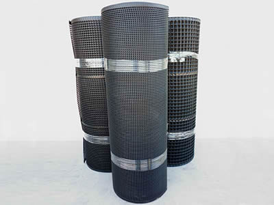 Three rolls of flat oyster mesh on the white background.