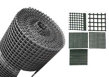 A roll and several pieces of oyster mesh in different mesh opening sizes.
